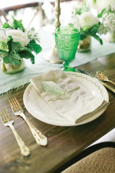 Summer Soirees - Orlando Magazine - June 2014 - Orlando, FL   What says summer more than all-green everything? Varying hues—from rich hunter green to soft artichoke green—come together to create a stunning bohemian wedding enhanced by white floral centerpieces, cream-colored dinnerware, and dainty leafy décor  Andi Mans Photography