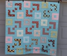 Hi everyone, it's Andrea from Urban Quiltworks, also known as Millions of Thoughts.  I love colour contrast in quilts, and I have created a quick and easy child's quilt for you to make using Boho b...