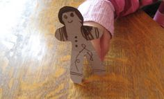 Cardboard gingerbread men finger puppet to decorate.  Paper finger loops stapled to the back.