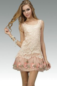 Elegant Sleeveless Lace Dress with Cut Out Detail