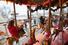 Members of the public enjoy a carousel adjacent to a Christmas market on the South Bank on Dec. 23, 2013 in London, England. With two days until Christmas day, many people have finished work for the festive season and retail forecasters are predicting a significant increase in gift purchases with many shops offering heavy discounts.