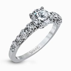 In love with the caviar collection by @simongjewelry These shimmering white diamonds accent this center stone perfectly.