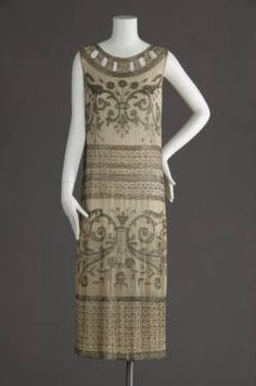 Wedding dress, 1924. Silk crepe, glass beads. Maker unknown.  Worn by Mamie Buffenstein on occasion of her marriage to William Nathan on June 3, 1924.