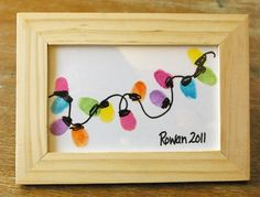 Beneath the Rowan Tree: Christmas Card :: Thumb Print String of Lights Definitely going to get some IKEA frames and have my students make these for their parents as a gift this holiday season!