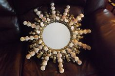 Sunburst Mirror decorated with shells, sea glass, floral glass pebbles.