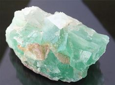 This large fluorite cube crystal cluster from the Erongo mountains in Namibia has light emerald green to clear crystals with beautiful gemmy translucency! The natural raw mineral specimen measures 4 x 2 1/2 x 1 7/8, weighs just over 1 lb. (472 grams), and has some minor matrix and druzy crystals