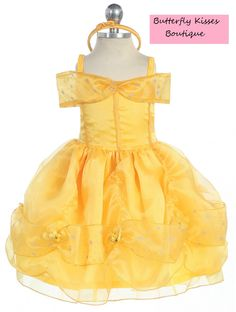 A Teeny Tiny Princess!  This Fairytale Cutie is ready for her Halloween debut! Her costume includes a sparkling yellow dress with flower details on the top, a scalloped fabric bottom with attached rosettes and a satin bow headband. 2 Piece set.  Infant Sizes: 12m, 18m, 24m  Polyester. Hand ...