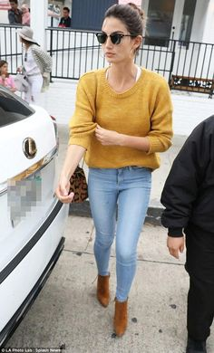 Lily Aldridge wearing Ray-Ban Clubmaster Acetate Sunglasses, Jerome Dreyfuss Popeye Shoulder Bag, Stuart Weitzman Grandiose Booties in Camel Suede, Isabel Marant Etoile Risha Sweater in Amber Gold and Frame Le Skinny De Jeanne Jeans in Antibes