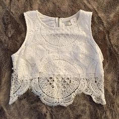"""LF Lace Eyelet White Crop Top Small New! $108 A brand new white lace scalloped crop top from LF. Size small, zips up the back, $108 retail with tag still attached. Spring 2015 collection. Last photo property of LF Stores. 16"""" from top of hem to lowest part of scallop, 11.75"""" from top of shoulder to bottom of lining. LF Tops Crop Tops"""
