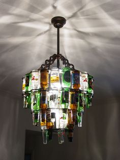 Unique beer bottle chandeliers and bar lighting. Hey @Jenn L Roe, you should make one for Richard's man cave! :P