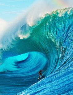 Big Wave. How many tons of water are perched like an anvil? Ready to drive you down into the coral reef and make fish food out of you.....