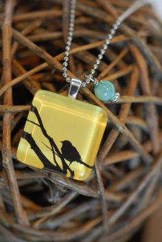Yellow bird pendant with bead charm. Designed my me (Jenni Lynn and Annabelle)
