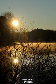 Sunrise on a lake at spring, Mandeville, Quebec, Canada Stock Photo