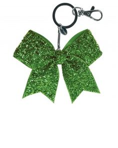 The Mini Glitter Bow Keychain provides all-over solid glitter coverage. Bow is attached to a key ring that you can clip on to bags.