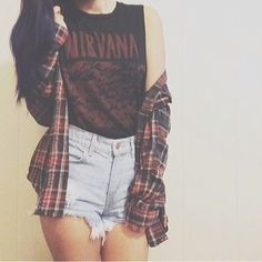 Grunge outfit. High waisted distressed denim shorts, Nirvana muscle tank, and a plaid button up.