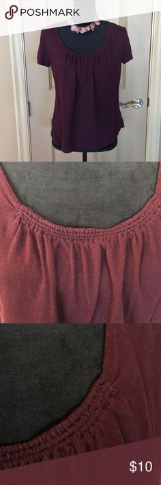 Daisy Fuentes knit top Gorgeous wine color.  Super soft and lightweight.  Elastic gathers at the neckline that creates subtle pleating.   Gently worn no flaws detected.   Bundle two or more items from my closet to save on shipping.   Let me know if you have any questions! Daisy Fuentes Tops