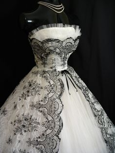 1950s dress with black floral lace. I love the designs. Like, Comment, Repin !!