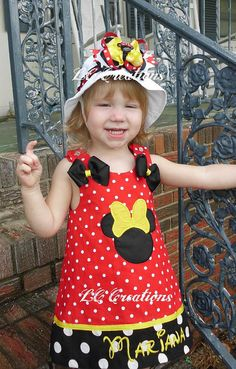 LOVE her dress!!!  Wonder if I can find one like this for Raelynn for our trip... ?