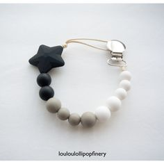 Shooting Star Silicone Soother Clip in Black. Available @louloulollipopfinery on etsy