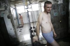 """Bosnian miners take a shower after getting out of the coal mine """"Sretno"""" (Good Luck), near the central Bosnian town of Breza December 20, 2013. Miners' Day falls on December 21 in Bosnia and Herzegovina. Picture taken December 20, 2013. REUTERS/Dado Ruvic"""