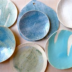 Michele Michael's Elephant Ceramics line. - I love the textured added to these plates; it kind of looks like a burlap sack or canvas was stamped into it.