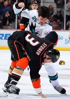 San Jose Sharks forward Tye McGinn pounds Clayton Stoner of the Anaheim Ducks (Dec 22, 2014).