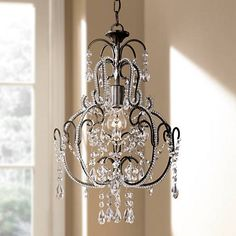 Even small spaces deserve some sparkle, and this mini chandelier by Minka Lavery delivers. high x 12 wide. Canopy is wide. Comes with of chain and of wire. Style # 31146 at Lamps Plus. Bathroom Chandelier, Farmhouse Chandelier, Bronze Chandelier, Pendant Chandelier, Chandelier Lighting, Bathrooms With Chandeliers, Small Chandelier Bedroom, Small Chandeliers, Dining Room Lighting