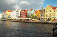 CURACAO - The capital Willemstad is beautiful with brightly colored pastel houses and businesses. #Curacao #Caribbean