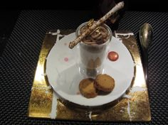In a Feuille d'or luna shape plate, Joël Robuchon at l'Atelier restaurant is presenting a gourmet dessert.