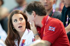 London Olympics, August 2012, Day 13 - Swimming. Kate with official team Great Britain, Robin Cousins watching the women's synchronized swimming.