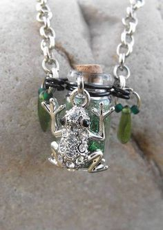 Tiny bottle necklaces - tiny frog hugging a bottle of green glitter