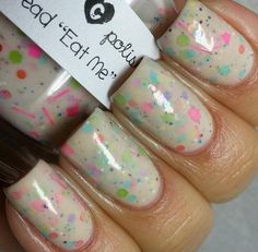 """The Tag Read """"Eat Me"""" is a unique nude crelly with neon and pastel glitters. It layers well and becomes opaque in 2-3 coats. This polish is inspired by the cakes Alice eats in the famous Alice in Wonderland story.This listing is for one full size bottle of polish. (15 ml/.5 fl oz) It has two stainless steel mixing balls and may require a topcoat for a smooth finish.All of my polishes are three free (free of Dibutyl Phthalate (DBP), Formaldehydeand Toluene)Due..."""
