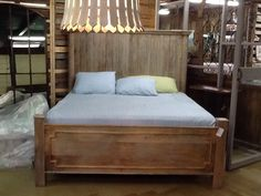 Sleep in comfort and style in this king size sold mango wood bed Mollywood imports