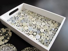 button tray...I made one of these with a rustic tray and really old buttons. Covered mine with resin...very cool!