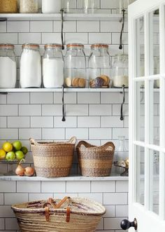 white pantry, glass jars, woven baskets, subway tile