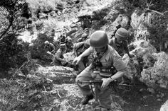 Crack German paratroops pick their way through rocky Tunisian terrain on a reconnaissance patrol. Groups like this were frequently guided by Arab scouts with specialised knowledge of a region Paratrooper, Luftwaffe, The Third Reich, American War, North Africa, World War Two, Wwii, Germany, Military