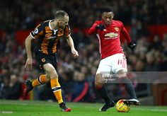 David Meyler of Hull City closes down Anthony Martial of Manchester United during the EFL Cup Semi-Final First Leg match between Manchester United and Hull City at Old Trafford on January 10, 2017 in Manchester, England.