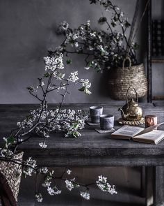 cherry blossoms & tea at the raw wood dining room table. wabi sabi. japan vibes photography & styling by Beth Kirby   localmilkblog.com   @local_milk #teatime #springflowers #slowliving