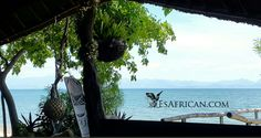 Looking across Lake Malawi towards the mountains from the bar at Nanchengwa Lodge