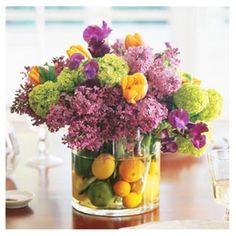 purple an yellow flowers with green hydrangeas and citrus fruits - spring flower centerpieces, floral arrangements, decor ideas