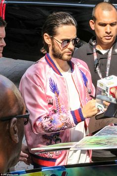 Running with it: Jared - pictured signing autographs - admitted that there were perks about petty thievery too, telling Rolling Stone, 'There are few greater feelings in the world than running from the police and getting away'