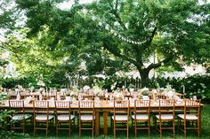 Long wood tables under the trees. Photo: Katie Stoops