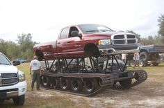 Red Dodge Ram truck on steroids for mudding