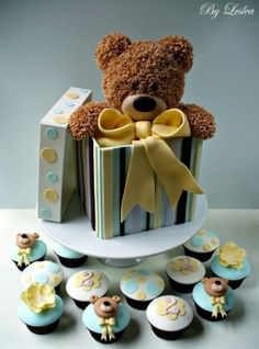 Bear in a box would be cute with balloons around him at center of tables...