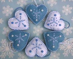 Handmade felt Christmas ornaments, blue and white snowflake hearts.  Three light blue felt hanging hearts, hand-embroidered with a snowflake pattern in white, finished with three tiny buttons and a loop for hanging .Height 7cm  Light blue with white embroidery and buttons.  You can see more felt heart ornaments here; https://www.etsy.com/ie/shop/PuffinPatchwork?ref=hdr_shop_menu&section_id=19324374#policies Heart Decorations, Handmade Christmas Decorations, Handmade Ornaments, Decoration Noel, Heart Ornament, Snowflake Ornaments, Felt Christmas Ornaments, Christmas Hearts, Blue Christmas