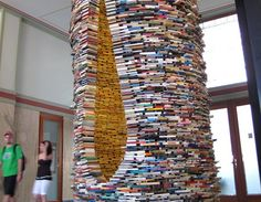 Book Tower:    The Prague Municipal Library is now home to a spiraling tower of hundreds of carefully stacked books assembled by Slovakian born artist Matej Kren. Dubbed Idiom, the staggering installation reaches up to the ceiling, and Kren installed a mirror inside the funnel to create the illusion of a magical, unending spire of books.