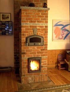Woodburning stove built as a custom brick fireplace. Cozy for any room!