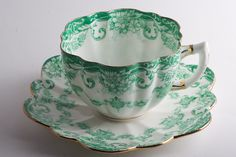Green Paragon 1908 teacup and saucer. Fine china with gilded edges & emerald floral motif.