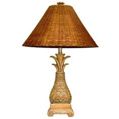 Update the decor of your home with this lovely tan lamp. This table lamp features a medium brown wicker shade with a beautiful pineapple design.