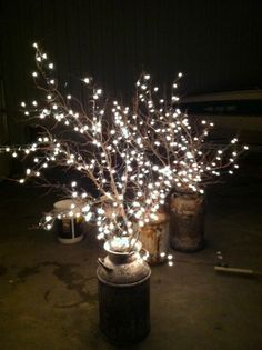 Use old milk cans, branches, and white lights!